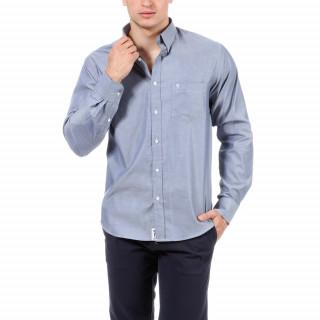 Chemise manches longues bleue avec logo brodé sur poche poitrine.