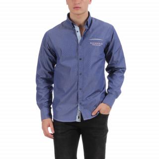 Chemise manches longues en coton bleu avec poche passepoilée et logo brodé.