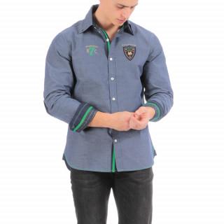 Chemise manches longues en coton bleu avec broderies et coudières.