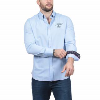Chemise manches longues en coton bleu avec logos brodés poitrine et dans le dos.Disponible du S au 5XL.