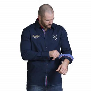 Chemise bleu marine à manches longues avec broderie et détails tricolores.  Disponible du S au 5XL