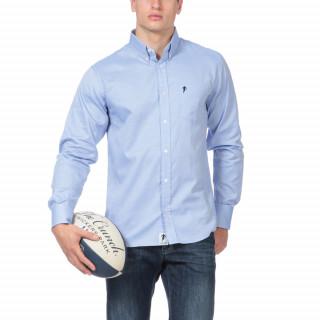 Chemise manches longues Essentiel rugby en 100% coton bleu ciel avec logo brodé sur poche poitrine.
