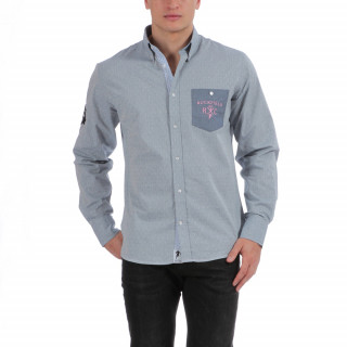Chemise manches longues en coton bleu avec poche poitrine et broderie.