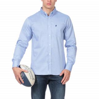 Chemise unie bleue avec poche et logo poitrine.