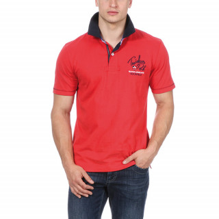 Polo with short sleeves in cotton jersey with twill collar. Front and back embroideries