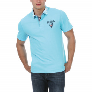 Turquoise polo with printed collar and beautiful embroideries.
