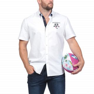 Short-sleeved white shirt with embroideries on the chest and back. Softness and comfort are reached thanks to the 3% of elastane within the fabric.