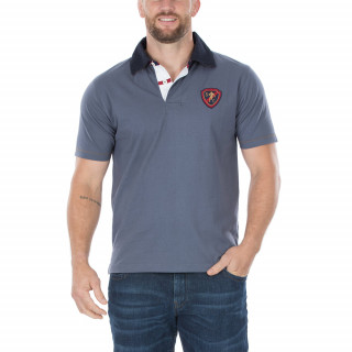 Polo manches courtes bleu vintage avec broderies poitrine et dos.
