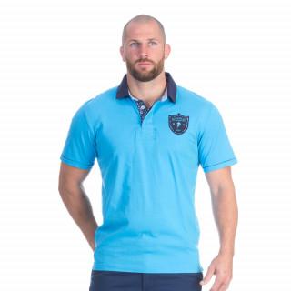 Polo manches courtes en coton jersey bleu turquoise avec broderies poitrine, dos et revers de col We are rugby