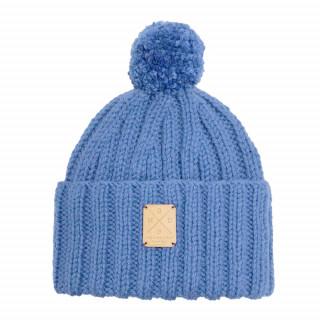 Bonnet bleu marine fait main en laine mérinos de grande qualité avec son pompon amovible et interchangeable.
